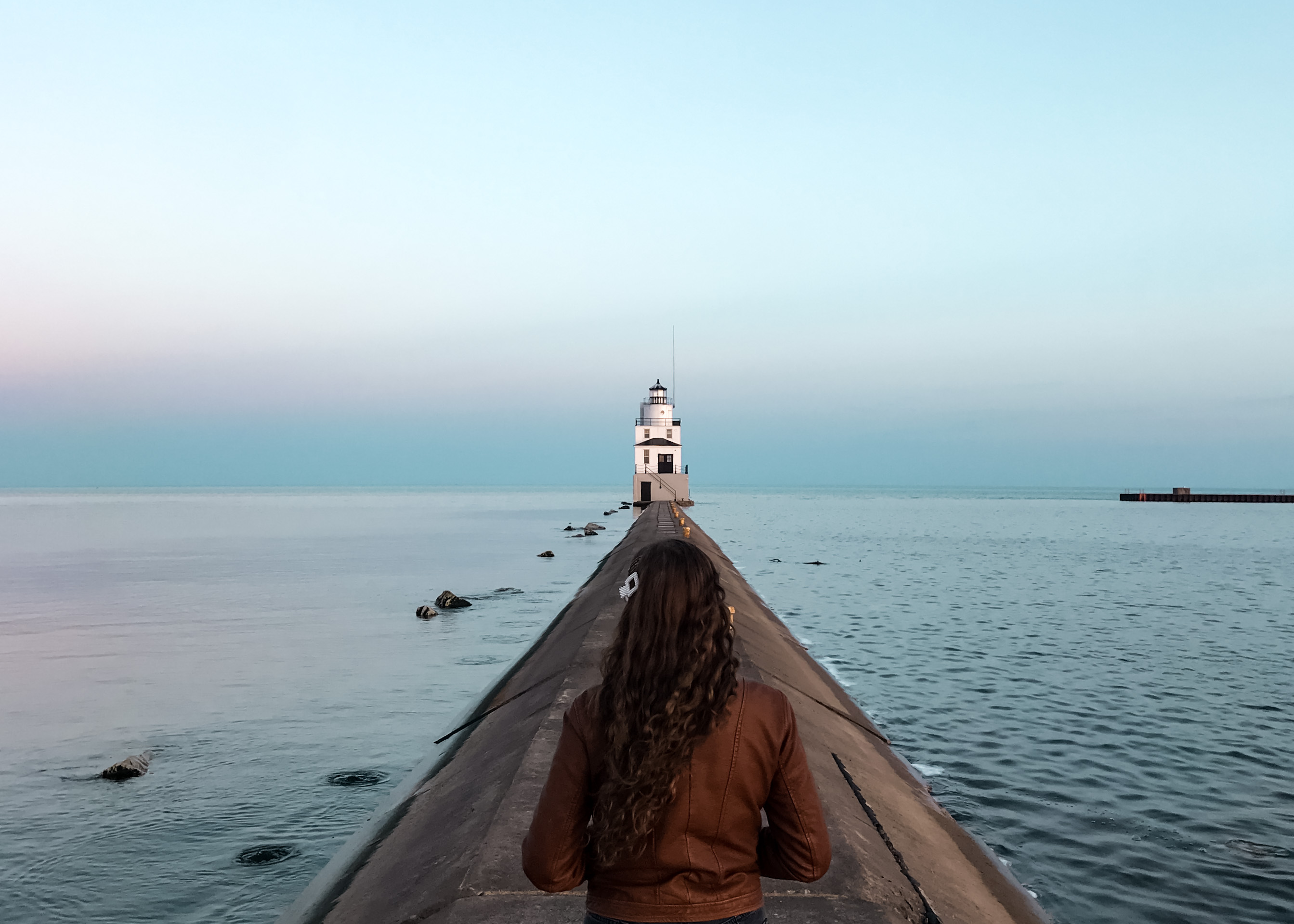 Indigo Sahara writes a poem about battling and supporting mental health. | Travel & wellness blog | lighthouse, sea, ocean, lake