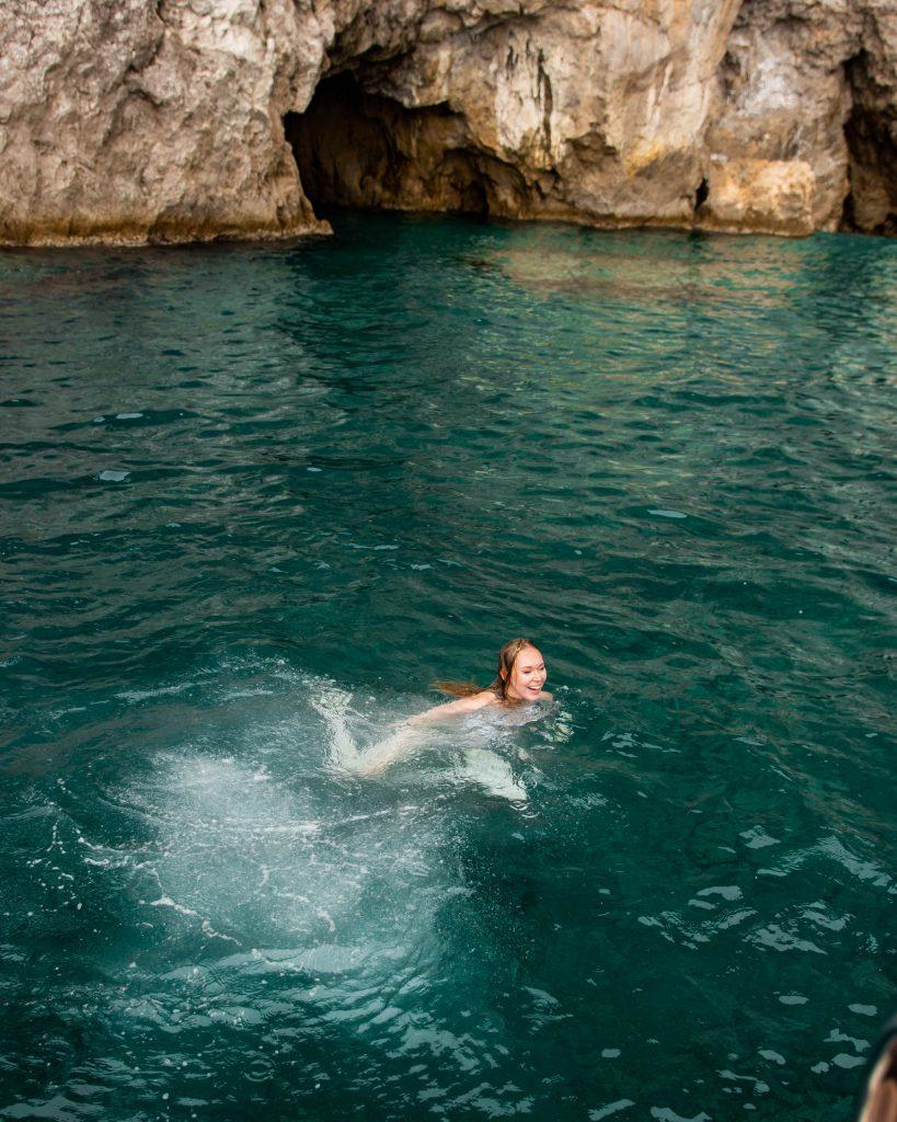 Swimming in the Mediterranean Sea of the Amalfi Coast in Positano, Italy (Blue Star boat tour)